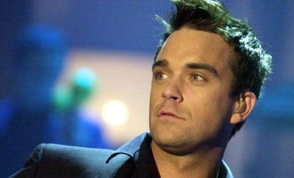 Robbie Williams : Un papa heureux